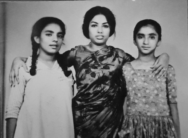 With her sisters.