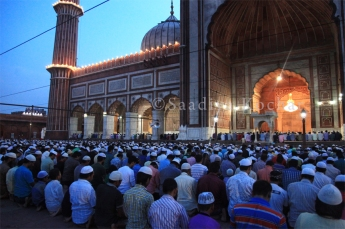 People from all over Delhi gather at the Jama Masjid for Iftiar, during the Holy Month of Ramadan