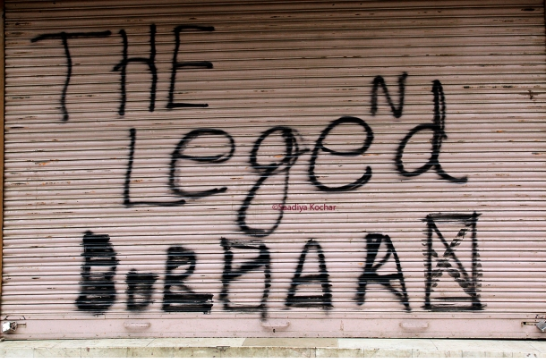 Graffiti on the shutters of shops.