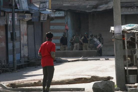 A couple of boys move towards the Karan Nagar side.