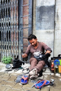 A Rajasthani man busy with his occupation while most parts of the city are under curfew.