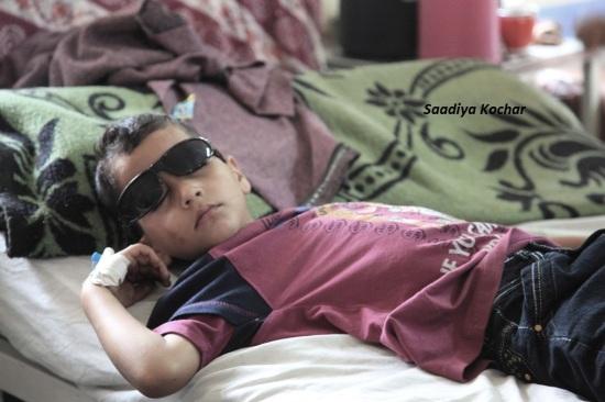 A child tries to sleep through his pellet injury.